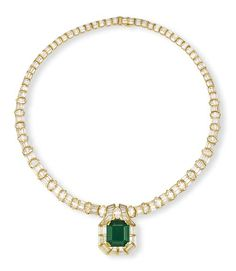 AN EMERALD AND DIAMOND NECKLACE  The front designed as a detachable pendant centering upon a cut-cornered rectangular-cut emerald weighing 14.16 carats, within a baguette and oval-shaped diamond surround to the graduated similarily-set diamond chain, also forming a bracelet, mounted in 18k gold, necklace 40.0 cm long, bracelet 19.7 cm long