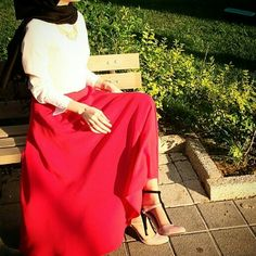 Like the way she is sitted and also the outfit(nice blouse and skirt) with nice heels too:)