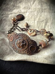 Bohemian assemblage bracelet with brass, beads and locket. $40.00, via Etsy.