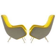 Pair of Aldo Morbelli Armchairs The designer of these chairs have a incorporated both curved and straight lines to add contrast to the chair.