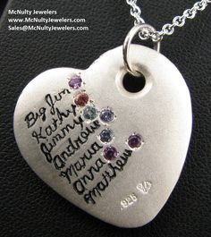 One of a kind heart pendant featuring the names and birthstones of loved ones.  McNulty Jewelers original design