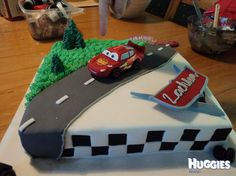 My son's 4th birthday cake was of Lightening McQueen on a race track.
