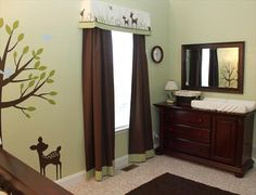 The bottom curtain detail and valance add a nice touch to the nursery design