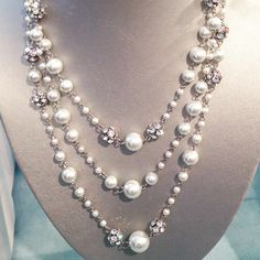 "This three strand silver tone chain linked glass pearl and crystal ball station necklace, gives an elegant layered look. - Available in white, pink and gray - Layered look starting at 16"" with 3"" exte"