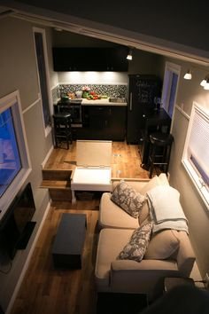 Built on a custom triaxle trailer this tiny house design features a full bathroom, including a full sized bathtub, and plenty of storage underneath kitchen. Insulated for Canadian winters (currently heated with only a space heater and it is plenty warm in -20), storage staircase up to the loft, and large windows that allow for plenty of natural sunlight.