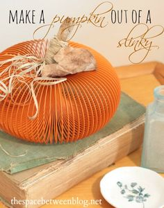This is so great!!!  Take a slinky and make it into a cute pumpkin.  Great pumpkin craft idea to do with the kids, too!!