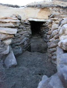 A photo of a large stone prehistoric house found during a coastal dig in Orkney for Historic Scotland