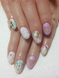 Cute pastel goth nails by DISCO nail salon in Tokyo  #nail #unhas #unha #nails #unhasdecoradas #nailart #pastel #cross #cruz #heart #coracao