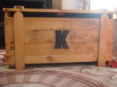 """Wooden Toy Box via Etsy.  I got this for Jared with a """"J"""" instead and it is just awesome.  Very sturdy and looks great in his room!"""