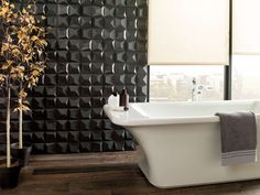 Bathroom Tile Ideas - Install 3D Tiles To Add Texture To Your Bathroom // Dark 3D tiles like these seem less harsh with the natural light hitting them and being reflected from different angles.