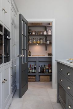 This open plan kitchen in Ingatestone has the perfect walk in pantry. Hidden beh… This open plan kitchen in Ingatestone has the perfect walk in pantry. Hidden behind a Georgian style door painted in H Kitchen Pantry Design, Kitchen Interior, New Kitchen, Kitchen Decor, Kitchen Larder Cupboard, Beige Kitchen, Pantry Cabinets, Awesome Kitchen, Open Plan Kitchen Diner