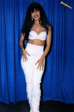 Love the red lipstick,and angelic white like,outfit! Beautiful w/your carmel like skin. Tejano queen.