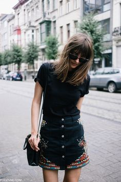 all black outfit with button down embellished skirt