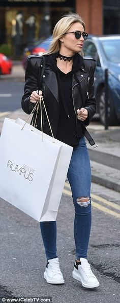 Casual: Flaunting her toned legs, she teamed it with ripped jeans and went casual in white trainers