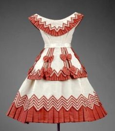 Child's Dress with very detailed stylish trim & contrasting colors.