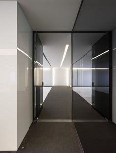 *modern interiors, architecture, minimalism, corridors, glass walls* - Clean and elegant corridor inside the Acer office in Barcelona by architect Francesc Rife _