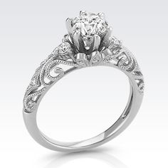 Vintage Diamond Engagement Ring with a Brilliant Round Diamond. Available with your choice of ruby, diamond or sapphire center stone.