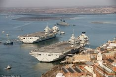 HMS Queen Elizabeth joins HMS Prince of Wales for the first time at the Royal Navy dockyar. Royal Navy Aircraft Carriers, Navy Carriers, Blue Angels Planes, Hms Prince Of Wales, Hms Ark Royal, Hms Queen Elizabeth, Portsmouth Harbour, Hms Hood, Navy Day