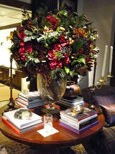 Love the floral arrangement. Ralph Lauren. El sillon y los almohadones!!!!