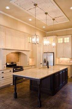 Readers clever upgrade ideas that wowed us iv kitchen design custom kitchen with tin panel ceiling detail aloadofball Image collections
