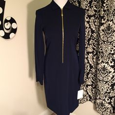 Calvin Klein sleek navy dress with gold accents. This is a gorgeous Calvin Klein dress!! Measures 37 & 1/2 inches from shoulder. The front zipper and small accent buttons on sleeves are in gold and stand out against this beautiful navy color. Love It!! If I do not sell it...lose 5pds and it is mine!! Calvin Klein Dresses Midi