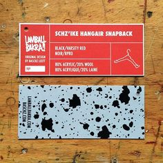 Vanity card/hang tag of the SCHZ'IKE hangAIR SNAPBACK hat; the wearable version of the 2006 hangAIR GOAThanger sculpture. Available from lamballbakra.com