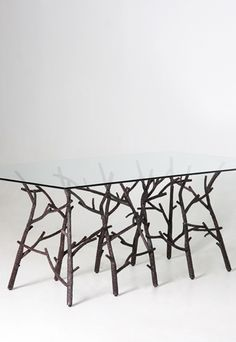 i chose this image because i liked the style of this table. use of organic shapes, branches used as the base or legs of the table. it looks classy, modern and stylish. Gives a very natural look.