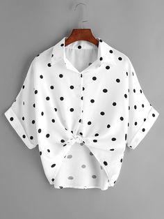 Textured-white-with-black-dots, with front tied knot at bottom of bottons, cuffed short sleeves blouse.