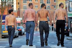 'Backvertisers': five exceptionally hairy men have had the Foster's logo waxed into their back hair.