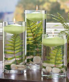 This inexpensive DIY floating candles with fern leaves is a very neutral piece to go with any home decor. Buy 3 different sized clear cylinder vases, a bag of white/tan rocks (or just pick some up outside), 3 fern leaves, 3 flat round candles in either a light green or tan color, lastly fill with water!