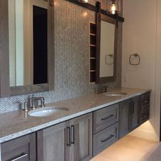 Barn door style mirror sliding over medicine cabinet - love it Master Bath in Hickory with Morel Stain Cambria Darlington featuring Dura Supreme floating vanity design by Cabinet Style Bathroom Storage Solutions, Mirror Cabinets, Sliding Mirror, Bathroom Makeover, Bathroom Mirror, Bathroom Vanity Mirror, Amazing Bathrooms, Bathroom Design, Bathroom Decor