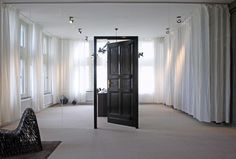 great use of a frameless glass wall!