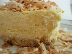 Frozen Coconut Pie  Mix 2 1/2 cups graham cracker crumbs and 1/2 cup butter, melted.  Press into 9x13 pan. In lg bowl, mix 1/2 gallon vanilla ice cream, softened, 1 1/2 cup milk, 2 (3 1/2 oz) pkgs instant coconut cream pudding and stir well. Pour in crust. Top with 8 oz Cool Whip and 1 cup toasted coconut, toasted.  Put in freezer for at least an hour.  Set out 10-15 min before serving.
