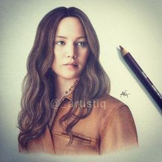 Katniss drawn with colored pencils by _artistiq on Twitter. WOW