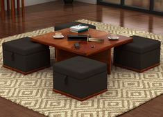 Give your #living room a prestigious look with this 3 in 1 centre table that has #stools with the #storage option.
