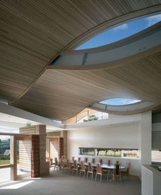 A garden setting for the new chapel led to natural for Office roof ceiling designs