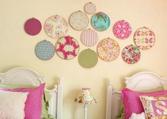 Embroidery hoops with fabric as wall decoration - minus the outside hoop.