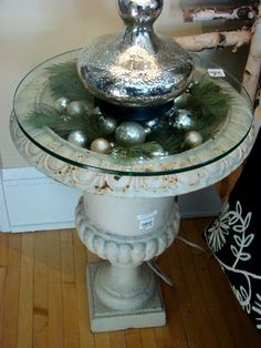 urn table created with glass top - wonder how top-heavy (probably not kid friendly, but so pretty!)