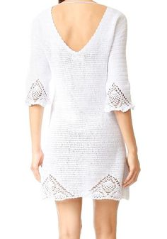 On point with this years trending crochet mini, MINKPINK's Knot Me Dress takes the cake. Intricate scalloped hem and a front lace-up tie closure add a unique spin on the crochet beach look. Details -