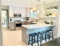 U shaped kitchen with peninsula and floating shelves. Gray base cabinets and white upper cabinets. Kitchen Interior, Kitchen Design Small, Kitchen Plans, Kitchen Peninsula, Kitchen Layout, Kitchen Remodel Design, Kitchen Design Plans, Kitchen Renovation, U Shaped Kitchen