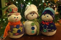The Easiest Handmade Winter Craft EVER! Sock Snowmen. Perfect for teacher Christmas gifts.