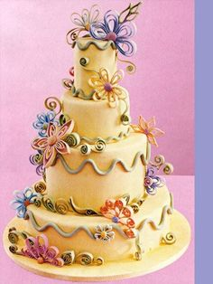 Quilling, i actually think I wouldnt mind a quilled wedding cake, made with color and shapes that describe, my/our personalities or maybe not the wedding cake, but a bride cake to go with the groom cake, wi option third wedding cake?