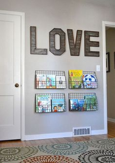 Baskets on a wall can serve the same function as a bookshelf... or can be a staging area for library books.