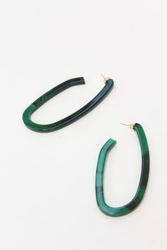 Acrylic hoop earrings, stud fastening for pierced ears. Plated steel post. Available in malachite or shell Made in Italy.
