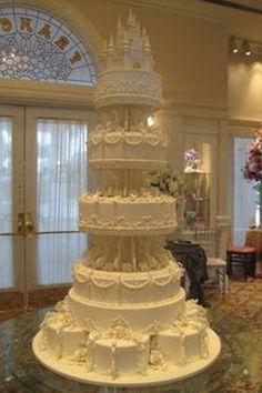 Amazing pure white Cinderella Castle Wedding Cake with exquisitely ornate decorations over five tiers. Extravagant Wedding Cakes, Amazing Wedding Cakes, Amazing Cakes, Large Wedding Cakes, Disney Cake Toppers, Disney Cakes, Castle Wedding Cake, Castle Cakes, Cinderella Wedding