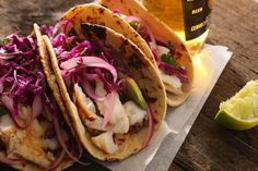 This easy fish tacos recipe uses grilled white fish. Marinate the fish with lime juice, garlic, cumin, chili powder, and then top with tangy cabbage slaw.