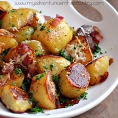 Oven Roasted Potatoes with Bacon and Parmesan    1 Tbsp olive oil  1/2 lb hickory smoked, thick sliced bacon  3 1/2 lbs Yukon Gold Potatoes  2 cloves garlic, minced  1/4 cup Parmigiano-Reggiano, freshly grated  coarse salt  fresh ground pepper  fresh parsley    Directions:  Scrub potatoes and place in a large pot.  Fill pot with water until potatoe