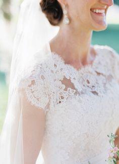 Delicate lace. Custom design by Penelope's Bridal in UT.