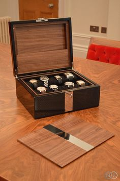 A luxury Watch Case in carbon fibre by Neal Jones Furniture. A perfect setting for your Patek Philippe or Rolex.   Why not check out #ChristiesWatches for a little inspiration...