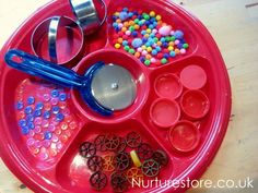 Invitation to make a playdough pizza. Items to offer the children as topping for their pizza could include pompoms, bottle tops, pasta pieces, buttons, marbles, dried beans, rice, lentils, and fresh or dried herbs.